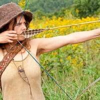 Natalie Bogwalker shooting a bow and arrow