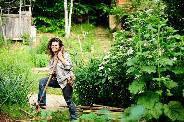 Natalie Bogwalker in her permaculture garden at wild abundance school