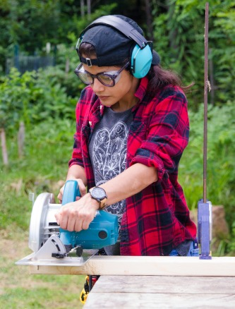 womens basic carpentry student using circular saw