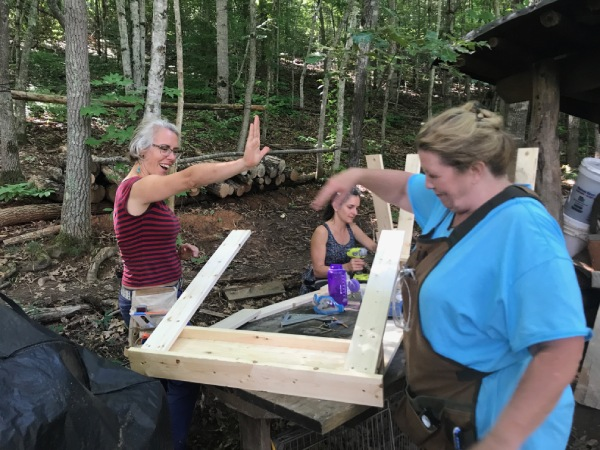women building sawhorses for woodworking
