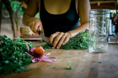 making medicine in herbal workshop