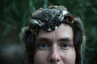 woman with handmade hat wild pelt rewilding