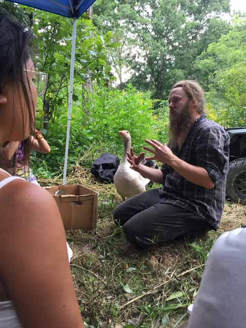 Osker Brown with a goose teaching permaculture