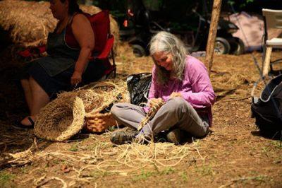 weaving a cattail fiber hat elder woman
