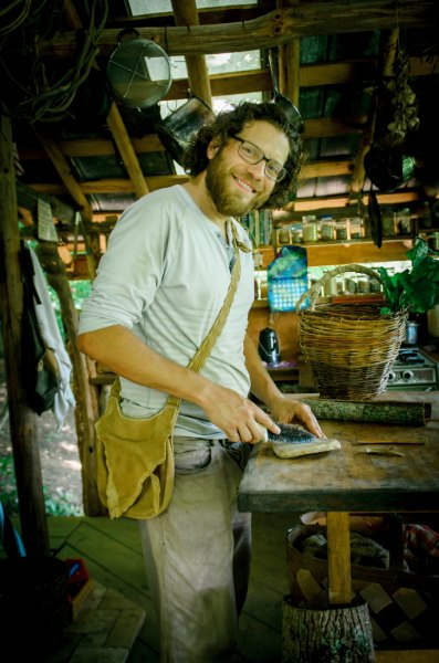 permaculture apprentice with buckskin bag