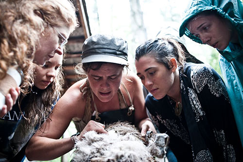 scraping hair off a deer hide for brain tanning
