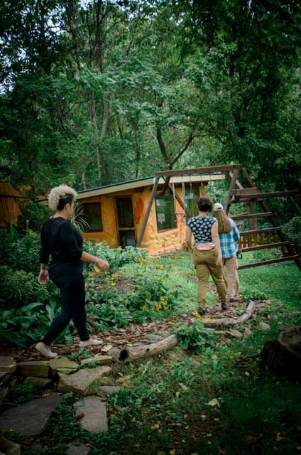 students exploring Asheville's tiny house nation