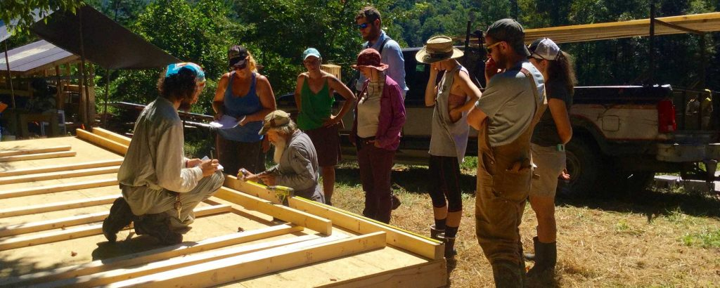 group of people building a tiny house