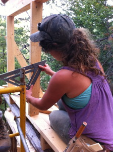 woman using a speed square for carpentry
