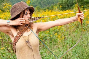 woman with bow and arrow rewilding