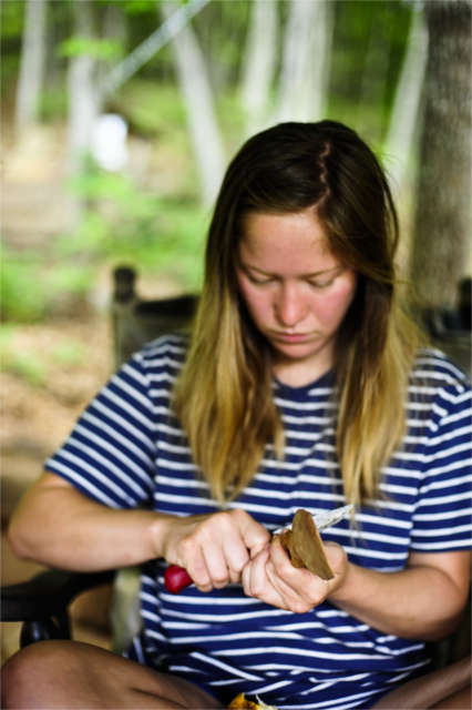 sustainability apprentice learning to carve a spoon