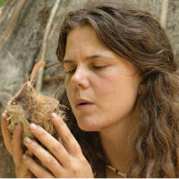 rewilding woman making friction fire