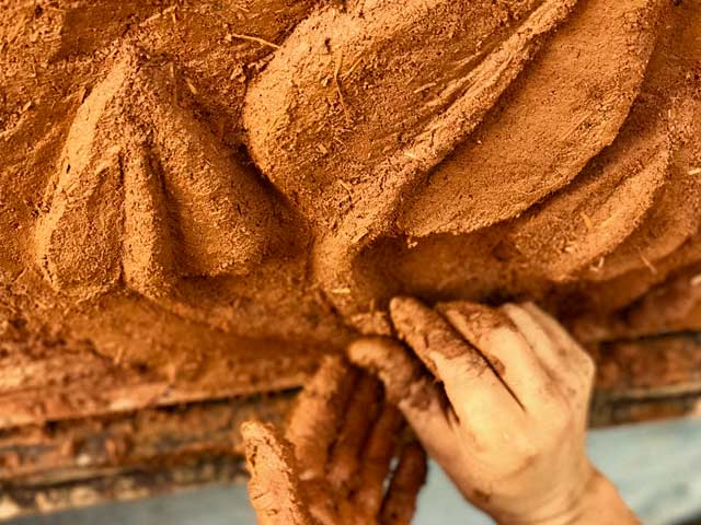 closeup of hands molding cob