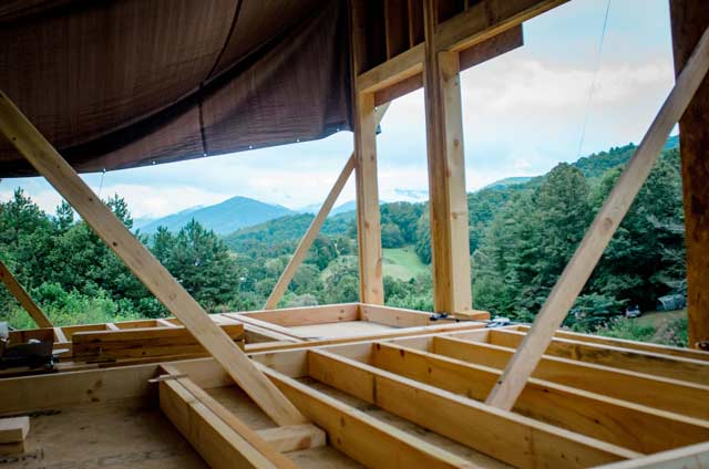 beautiful view of blue ridge mountains and framing a loft in a tiny house