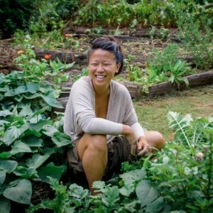 permaculture apprentice in the garden