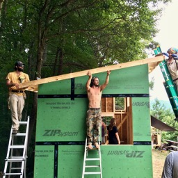 team of people building a tiny house