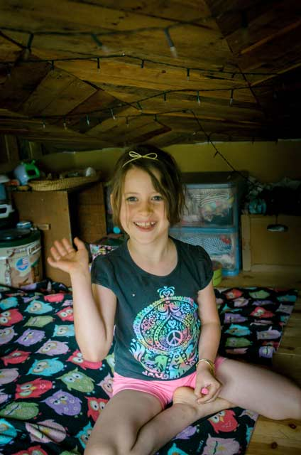 little girl in a loft bedroom in a tiny house
