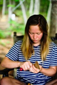 apprentice carving a spoon