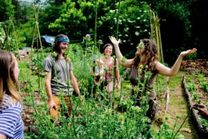 Natalie Bogwalker with apprentices in Wild Abundance garden