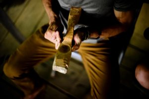 carving a wooden spoon with a knife
