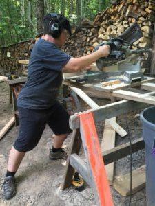 woman using chop saw