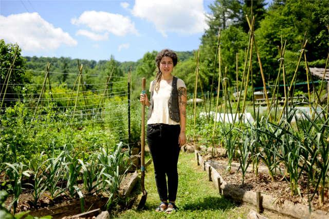 permaculture apprentice in garden