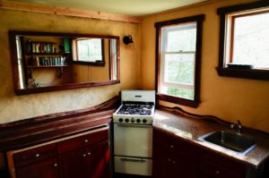 Yellow DIY paint on kitchen walls with natural wood counter tops