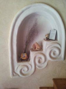 hand sculpted nicho in cobb wall painted with natural diy paint