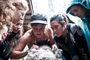 woman identifying membrane during hide tanning teaching