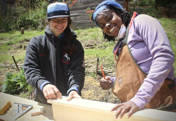 womens carpentry class instructor and student