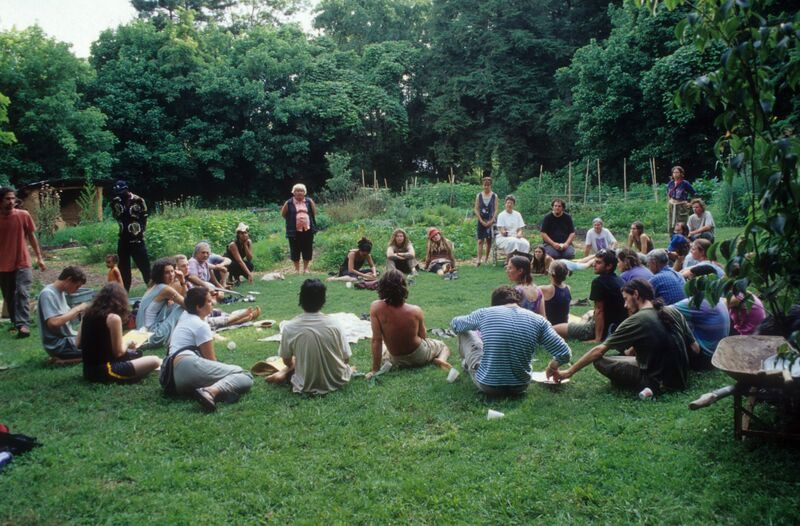 Group of people sitting in a circle forming an intentional community
