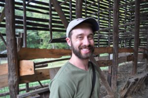 Josh Riley Permaculture Design Course Student in an old tobacco barn