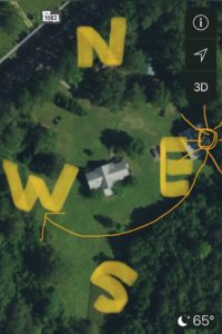 an aerial map of a home with the cardinal directions and path of the sun marked
