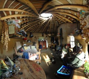 natural building small house with people inside beautiful spiral ceiling