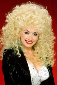 dolly parton with a perm in the eighties
