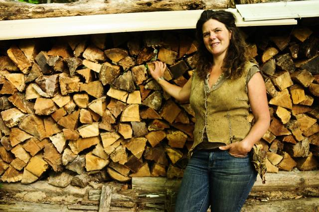 natalie bogwalker with firewood at permaculture and homestead school