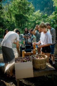 students in a Permaculture Design Course pressing apple cider