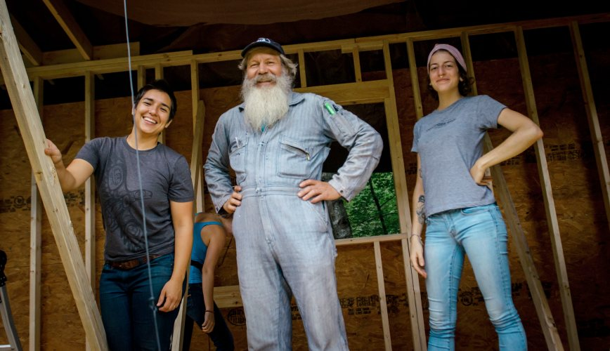 tiny house class students with building instructor