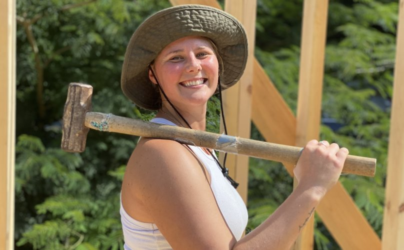 tiny house class student with sledgehammer