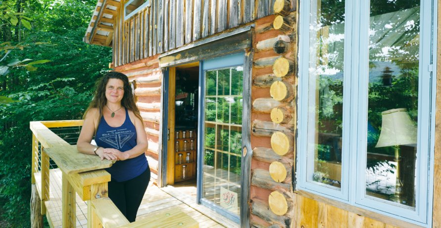 online tiny house academy instructor with her tiny log cabin