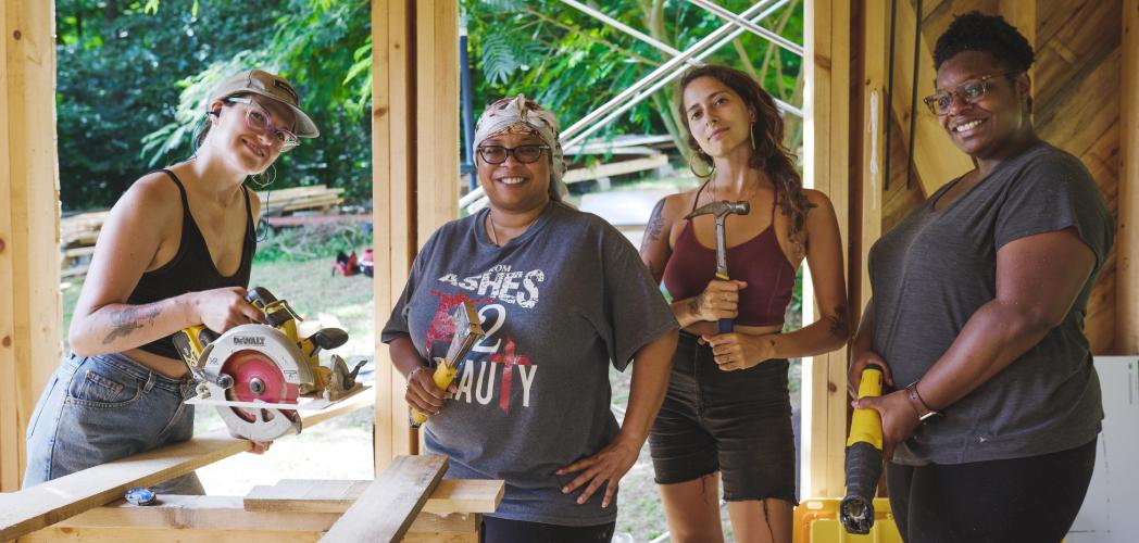 women tiny house class students with tools