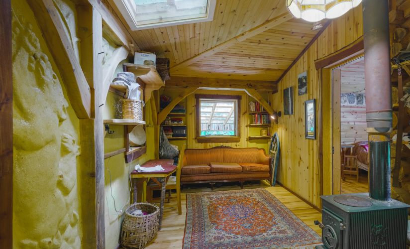 naturally built tiny house with timbers and cob