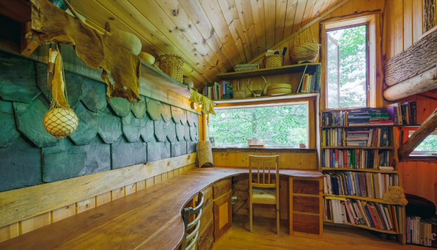 tiny house built with slate wall and other natural materials