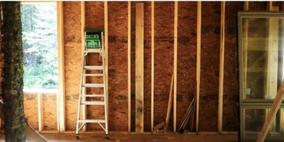 ladder and framed wall in tiny house