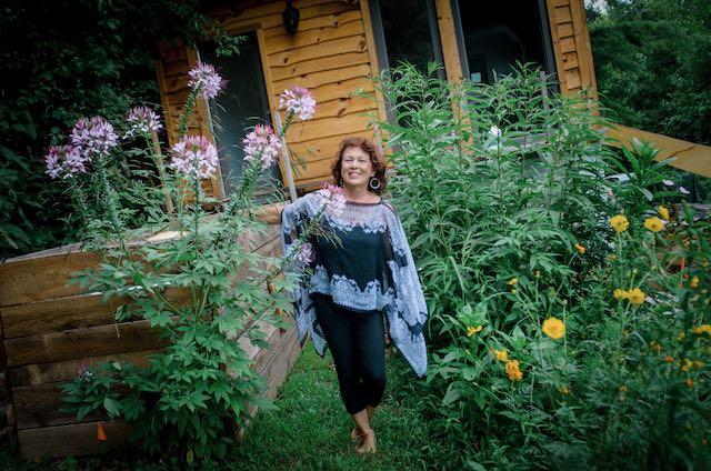 woman in a dress in her flower garden