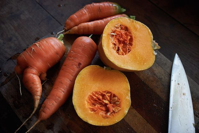 carrots and squash on a cutting board