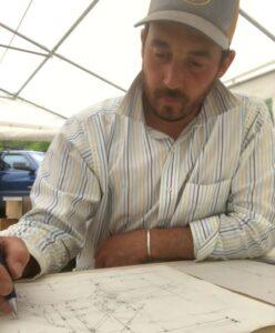building instructor creating timber frame plans