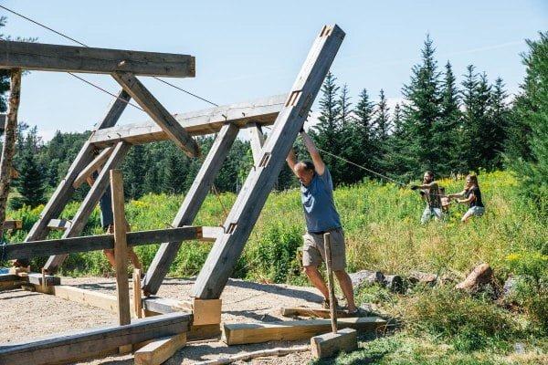 people raising timber frame wall
