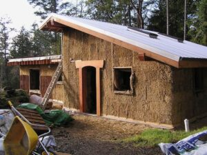 Timber frame with straw bale infill