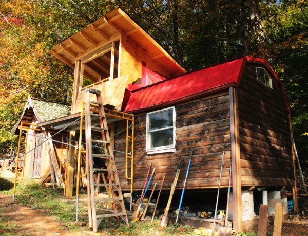 partially built tiny house and tools for building